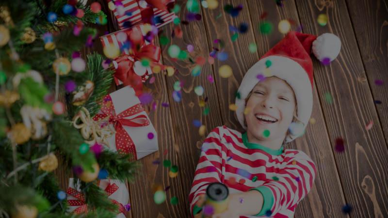 happy child wearing Santa hat