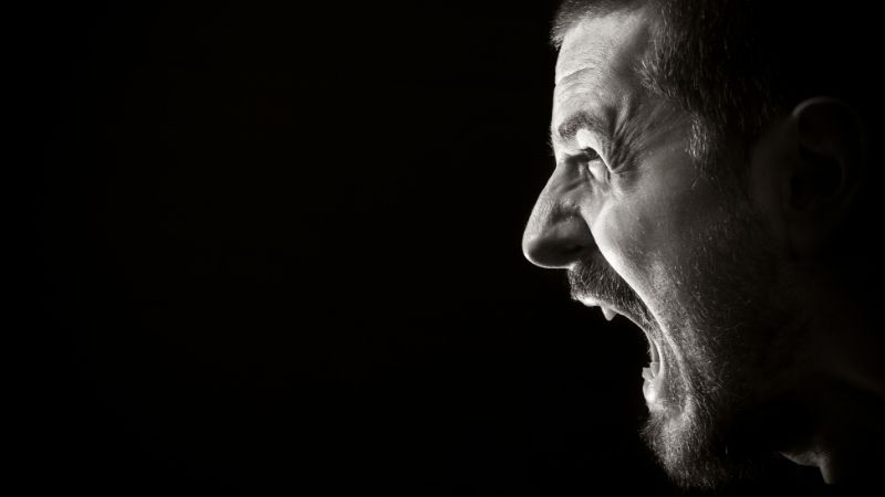profile of man screaming in anger