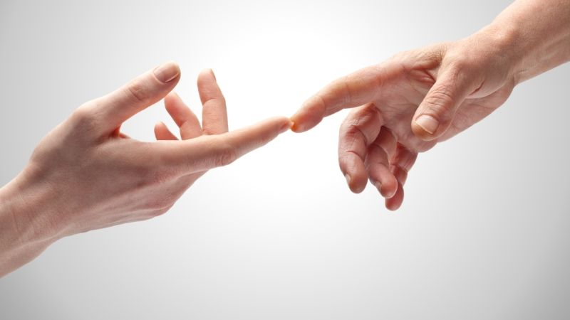 two hands, each with one fingertip touching each other
