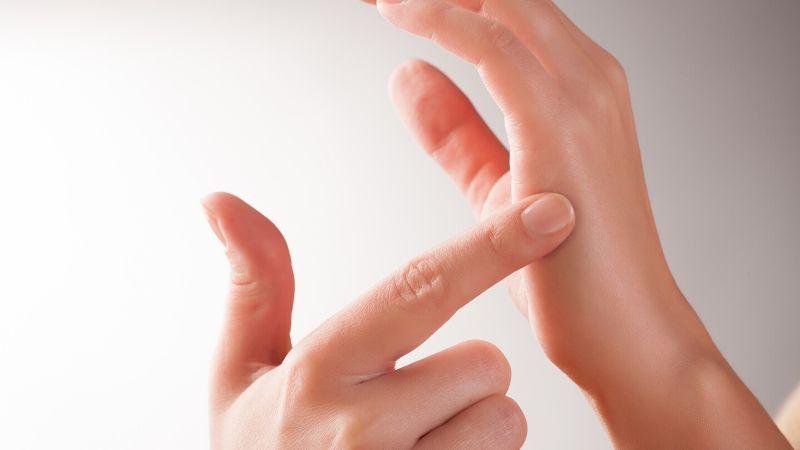 finger pressing a trigger point